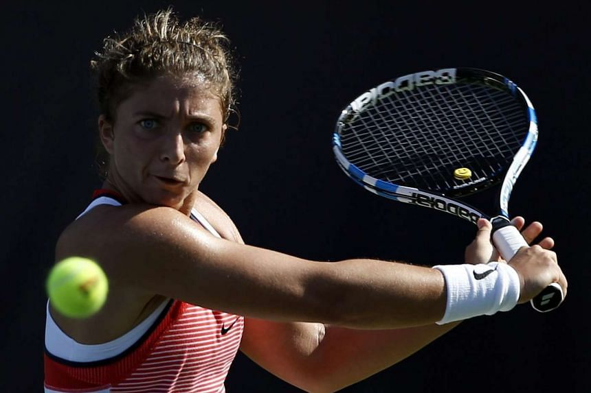 Errani (above) defeated Barbora Strycova 6-0, 6-2.