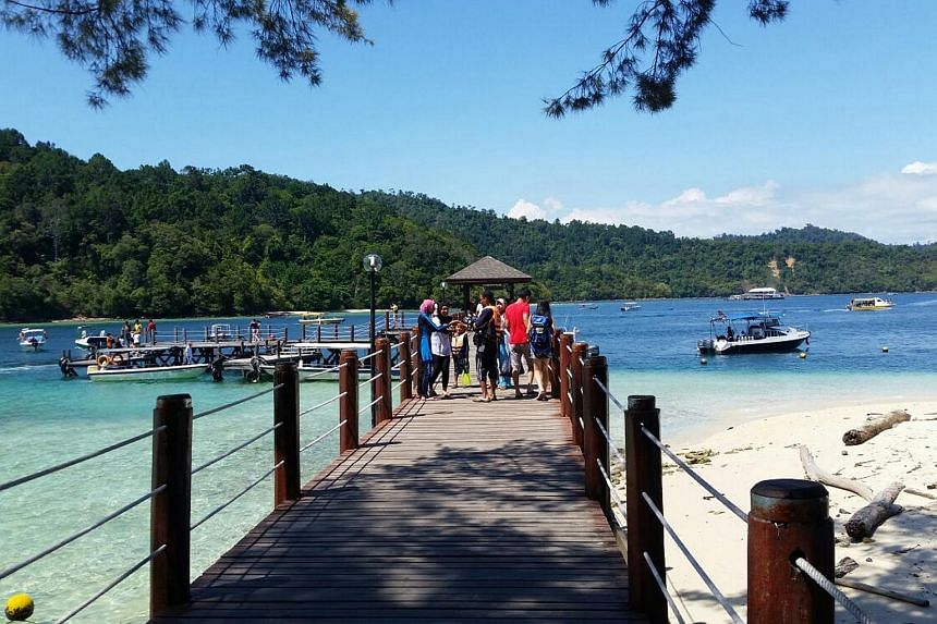 The view of the jetty in Sapi Island, located in Sabah, Malaysia.