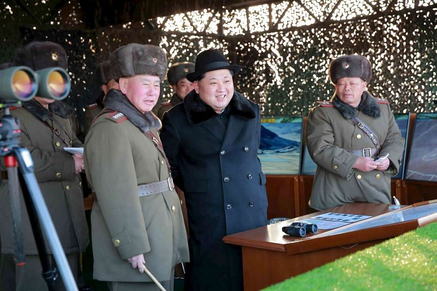 North Korean leader Kim Jong Un watching military drills conducted by the Korean People's Army.