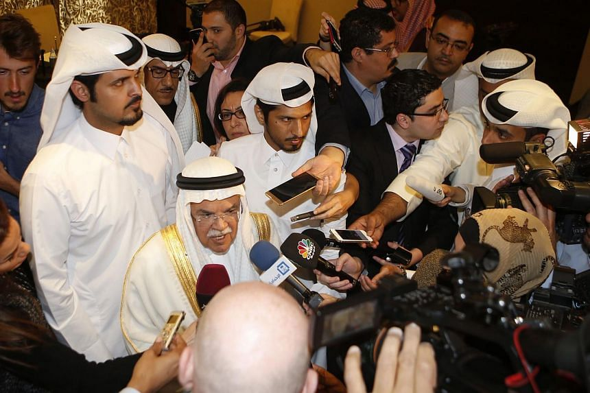 Saudi Minister of Oil and Mineral Resources Ali al-Naimi (centre), speaks to reporters in Doha, Qatar, on Feb 16, 2016.