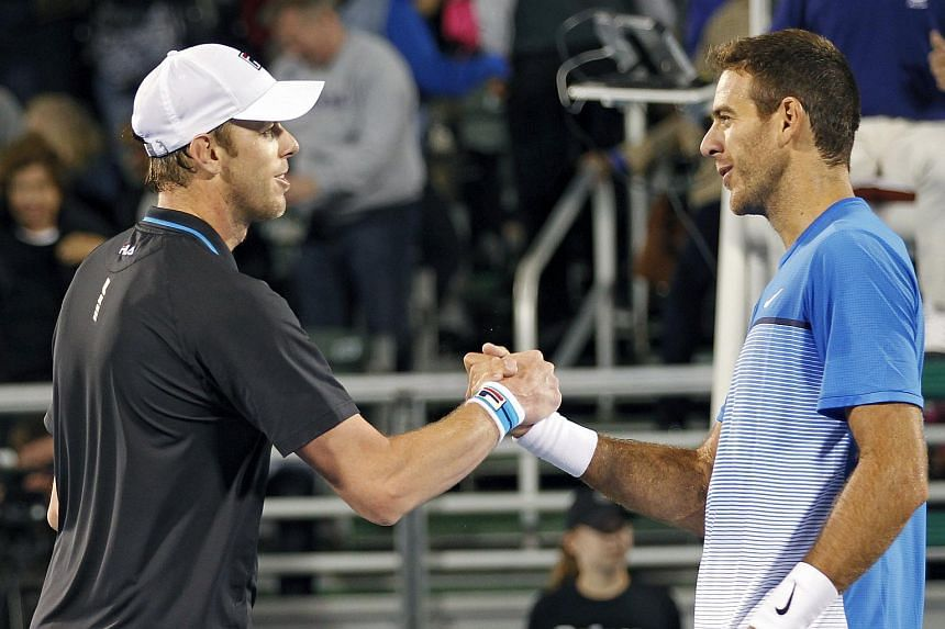 Sam Querrey (left) shaking hands with Juan Martin del Potro after winning his semi-final match at the Delray Beach Open, on Feb 20, 2016.