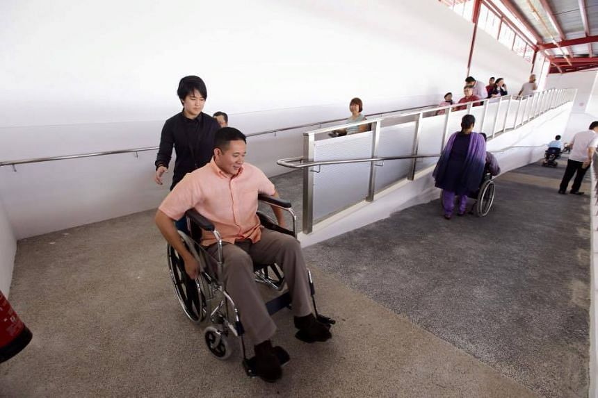 Mr Amrin Amin tried the new ramp at the temporary Woodlands Bus Interchange while on a wheelchair.
