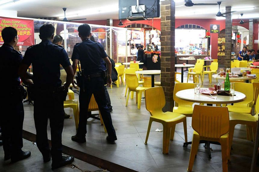 Police investigate a fight at a coffee shop at Hougang Avenue 4 on Feb 21, 2016.