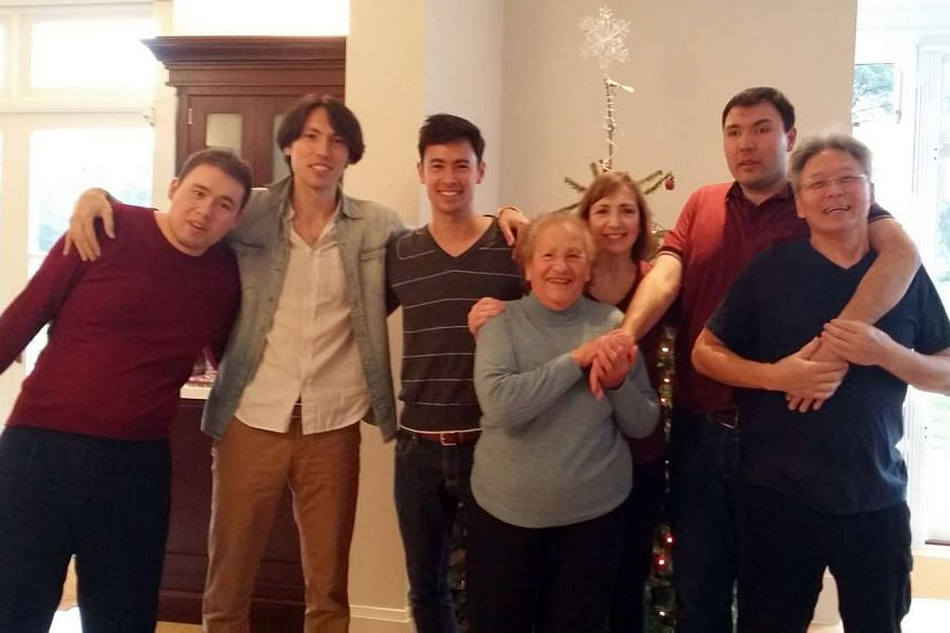 Actor-host George Young (third from left) with his brothers (from left) Paul, Anthony and Andrew as well as his grandmother and parents at a Christmas gathering in 2013.