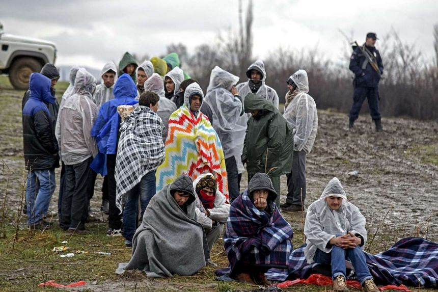 A group of Afghan refugees wait for permission to cross the border from Macedonia to Serbia near Tabanovce, Kumanovo, The Former Yugoslav Reublic of Macedonia, on Feb 20, 2016.