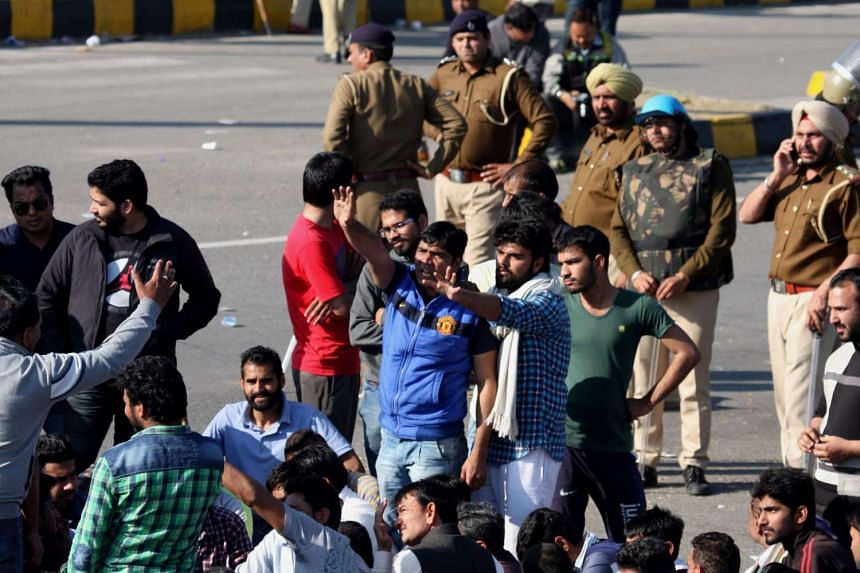 Indian residents from the Jat community blocking the Chandigarh-Shimla highway in Panchkula on Feb 21, 2016.