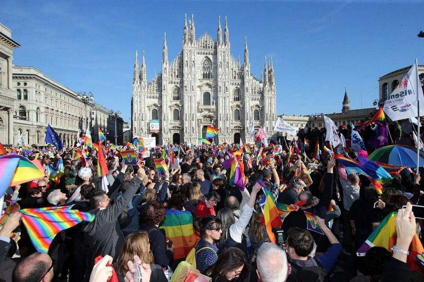 Demonstrators take part in a protest for gay rights in front of Milan Cathedral, in Milan, Italy, on Feb 21, 2016.