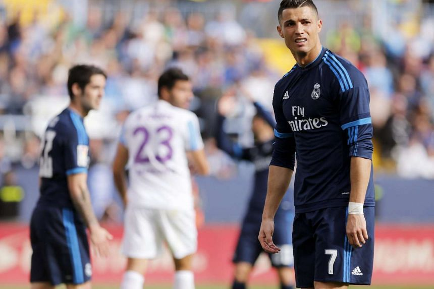 Real Madrid's Portuguese forward Cristiano Ronaldo reacts after missing a goal chance during his team's Primera Division Liga match held against Malaga at the Rosaleda stadium in Malaga, Spain, on Feb 21, 2016.