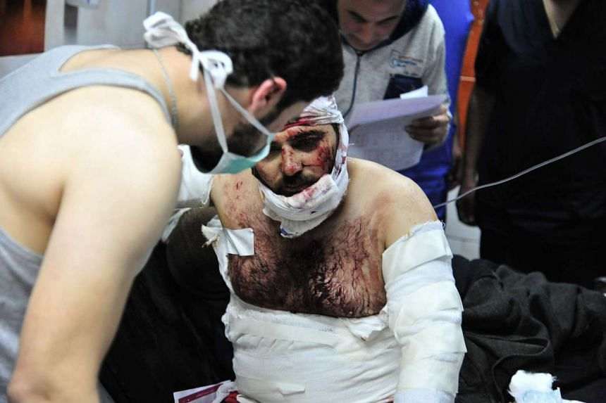 A handout picture from the Syrian Arab News Agency shows a wounded Syrian man receiving first aid at a hospital in Damascus, Syria, on Feb 21, 2016.