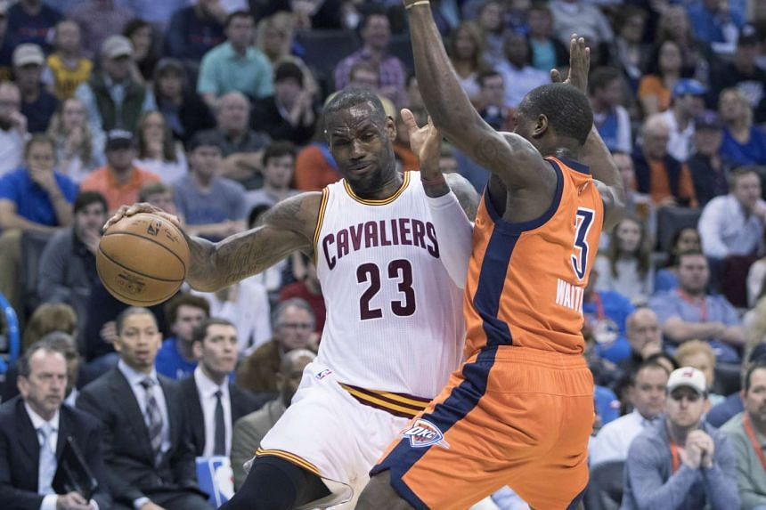 LeBron James #23 of the Cleveland Cavaliers tries to drive around Dion Waiters #3 of the Oklahoma City Thunder.