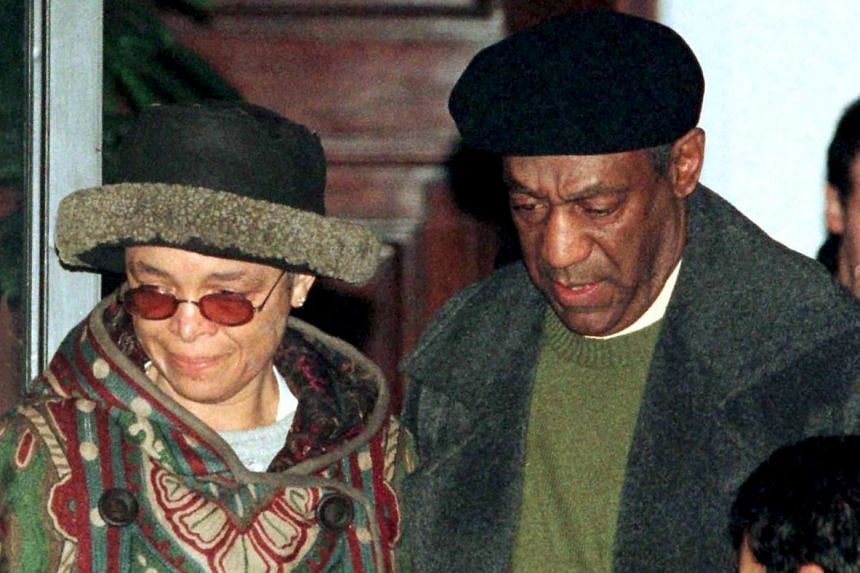 Comedian Bill Cosby and his wife Camille leave their New York apartment en route to Los Angeles in this Jan 16, 1997 file photo.