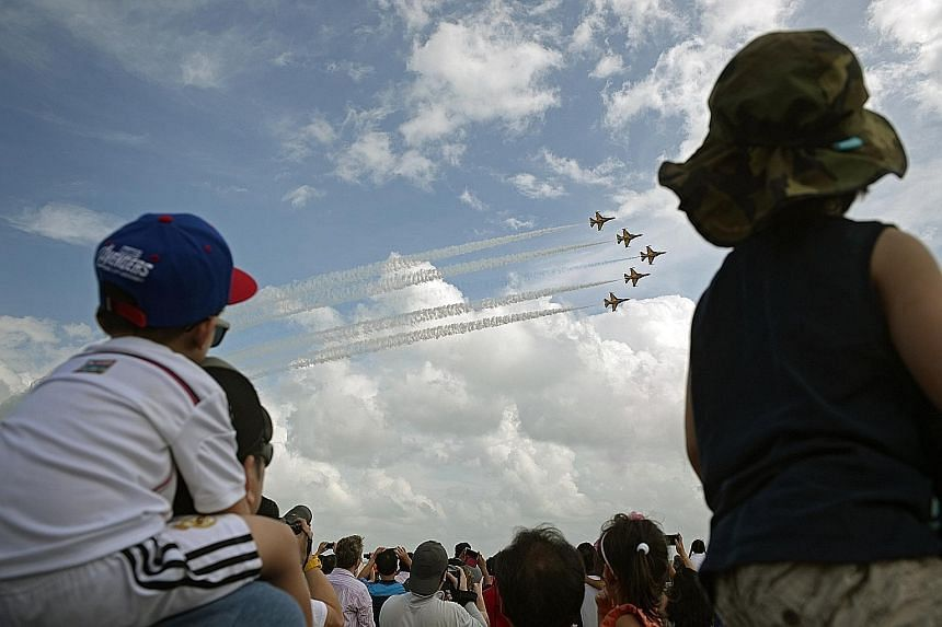 Visitors to the Singapore Airshow yesterday cheering and snapping photos as South Korea's Black Eagles aerobatic team soared to the skies with some heart-stopping aerial displays. The airshow, which ran from last Tuesday to yesterday, saw more than 1