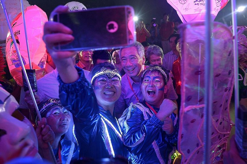 The Chingay festivities moved from downtown Singapore to the heartland last night as 2,000 performers entertained the crowds in Bishan-Ang Mo Kio Park. Prime Minister Lee Hsien Loong and Mrs Lee joined 50,000 people at the Chingay Night Fiesta, which