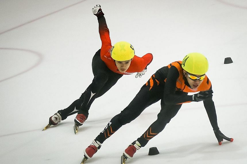 Lucas Ng of Singapore (left) attempting to overtake Wong De-vin of Malaysia at the Rink at JCube. He eventually won the 1,000m final to add to his 500m and 1,500m titles on Saturday.
