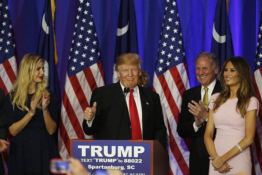 Mr Donald Trump giving a thumbs up, with (from left) his daughter Ivanka and wife Melania watching, during a South Carolina primary night rally in Spartanburg, South Carolina, last Saturday. The ability to build on his big win in New Hampshire means