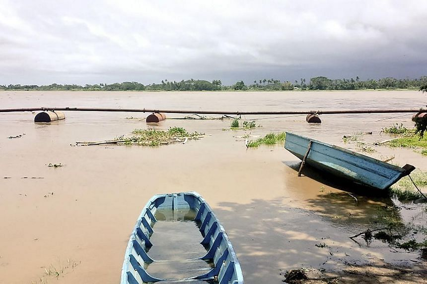 The flooded Wainibokasi jetty in the town of Nausori after Fiji was struck by severe tropical cyclone Winston.