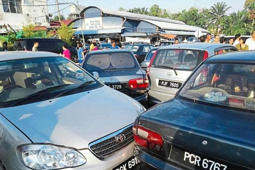 Damaged cars piled up after a lorry driver rammed his way through them near a public market in Taman Berjaya, Penang, on Feb 21, 2016.