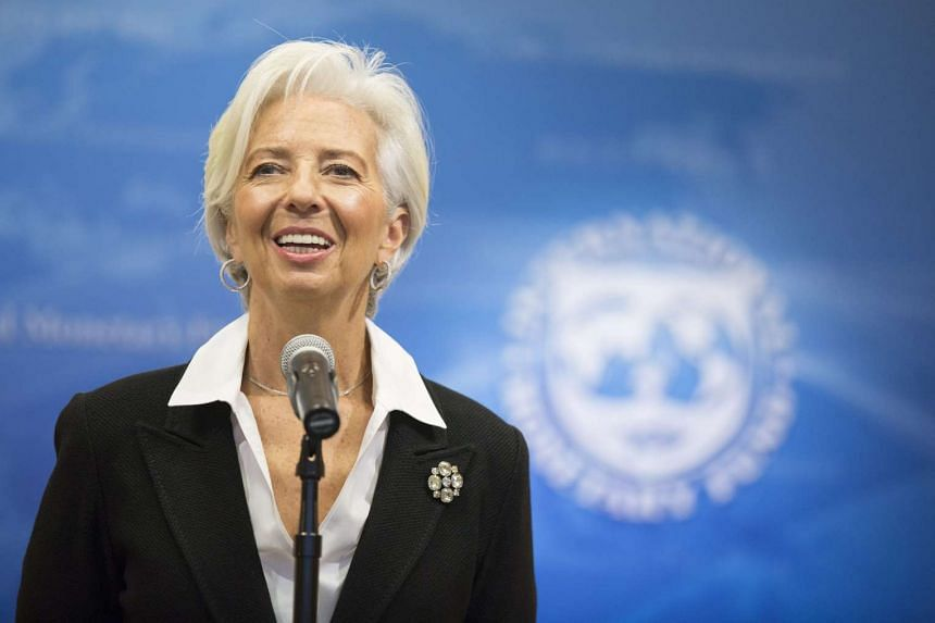 IMF Managing Director Christine Lagarde urged Gulf Arab oil-producing countries to cut spending and boost revenue through new taxes.