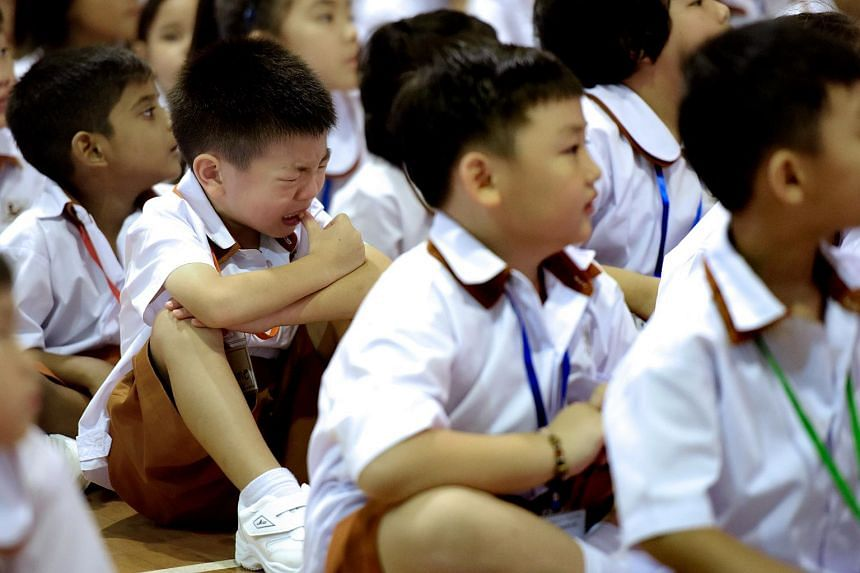 A primary one pupil cries during the first day of school at Ahmad Ibrahim Primary School, Jan 4, 2016.