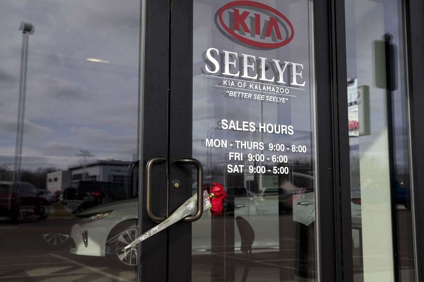A rose is placed in the door at the Kia Dealship where a gunman went on a shooting rampage on Sunday (Feb 21)  in Kalamazoo, Michigan.