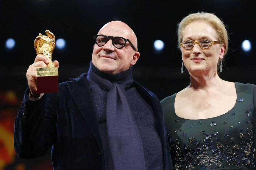 Director Gianfranco Rosi with jury president and actress Meryl Streep after receiving the Golden Bear for the documentary, Fuocoammare (Fire At Sea).