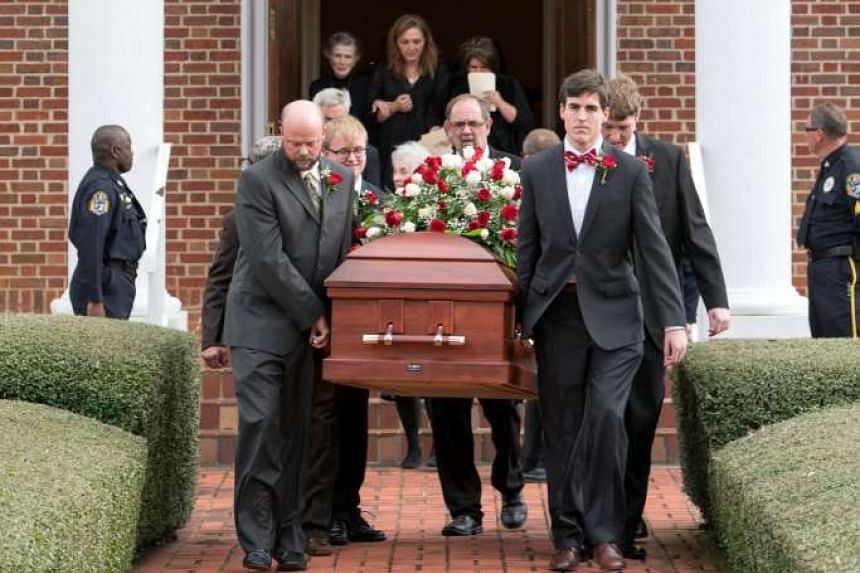 Pallbearers carry Harper Lee's coffin out of the First United Methodist Church during her funeral service in Monroeville last Saturday
