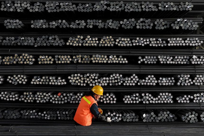 A labourer marks steel bars at a steel and iron factory in Huai'an, Jiangsu province, China.