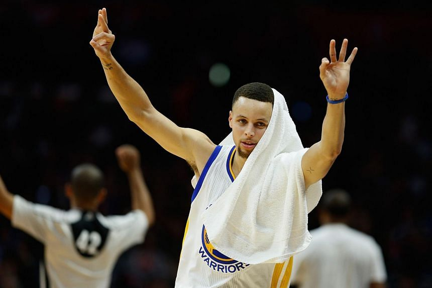 Stephen Curry #30 of the Golden State Warriors celebrates during the second half of a game against the Los Angeles Clippers.
