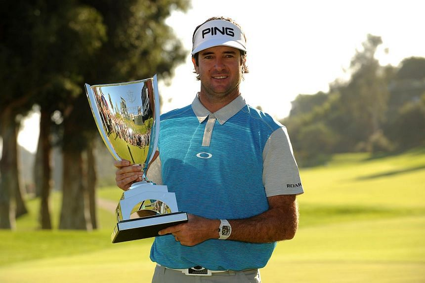 Bubba Watson poses with the winners trophy following his victory of the Northern Trust Open.