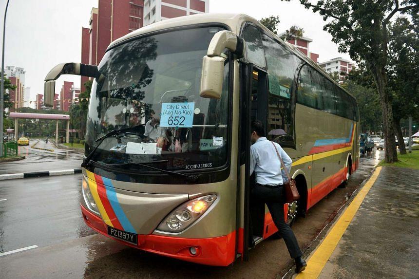 A commuter boarding a City Direct Bus Service.