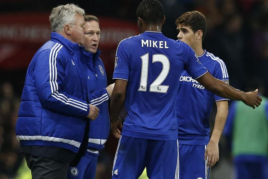 Chelsea midfielder John Obi Mikel wants interim manager Guus Hiddink (left) to extend his stay at the club beyond the current season.