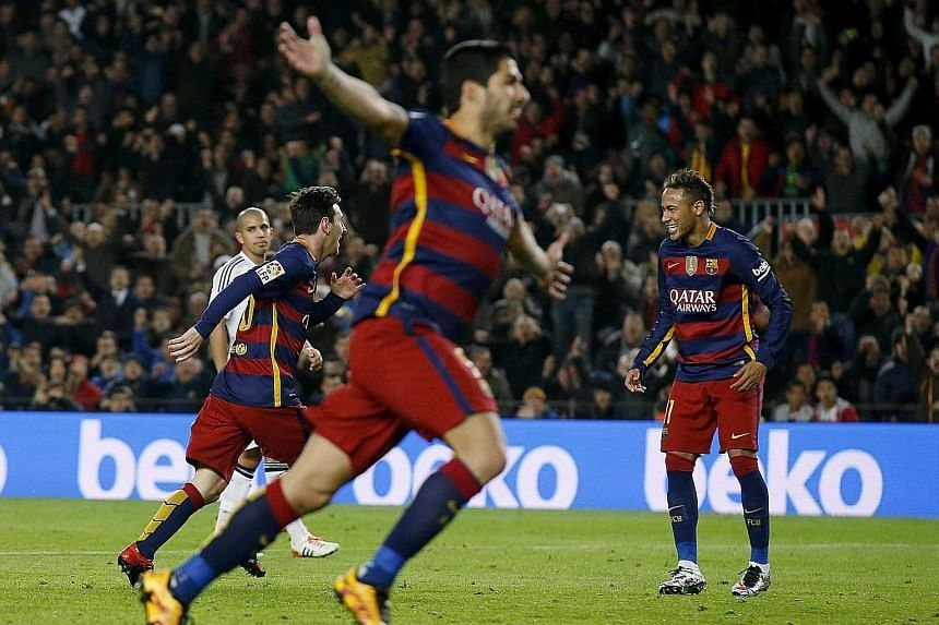 Lionel Messi (left), Luis Suarez and Neymar celebrate a goal in the decisive 7-0 rout against Valencia on Feb 3. The prolific members of the trident have scored a total of 91 goals for Barcelona and have set up 73 assists for each other in total.