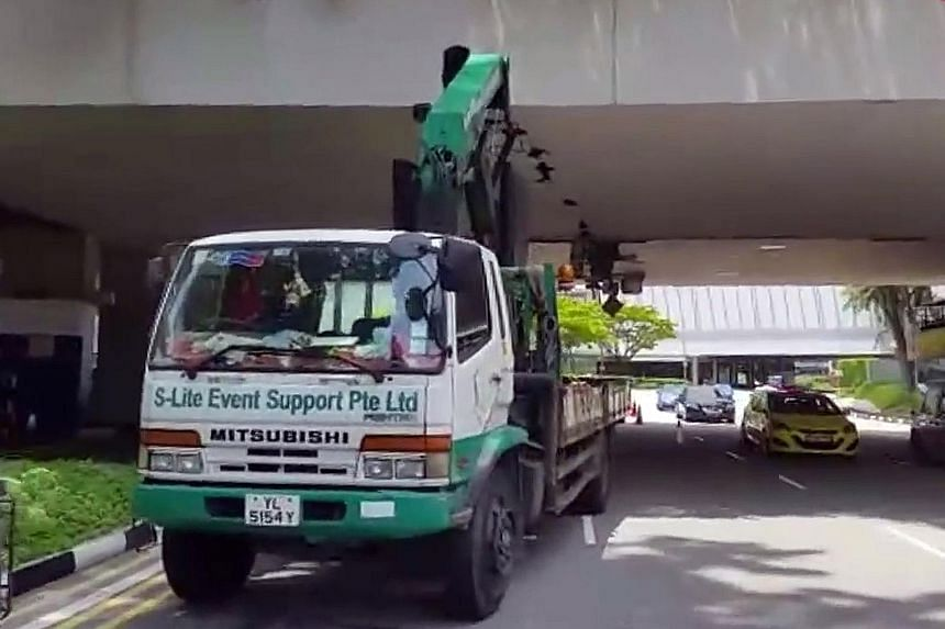 A 56-year-old lorry driver has been arrested in connection with the damage to the bottom of an overhead bridge in Raffles Boulevard. The crane boom, or lifting arm, of the lorry had allegedly caused the damage to the bridge linking Marina Square and