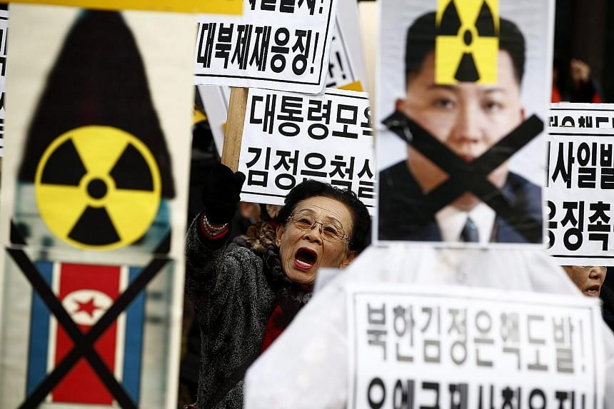 South Korean activists with placards and portraits of North Korean leader Kim Jong Un during a rally in Seoul earlier this month against his regime's long-range rocket and nuclear tests this year.