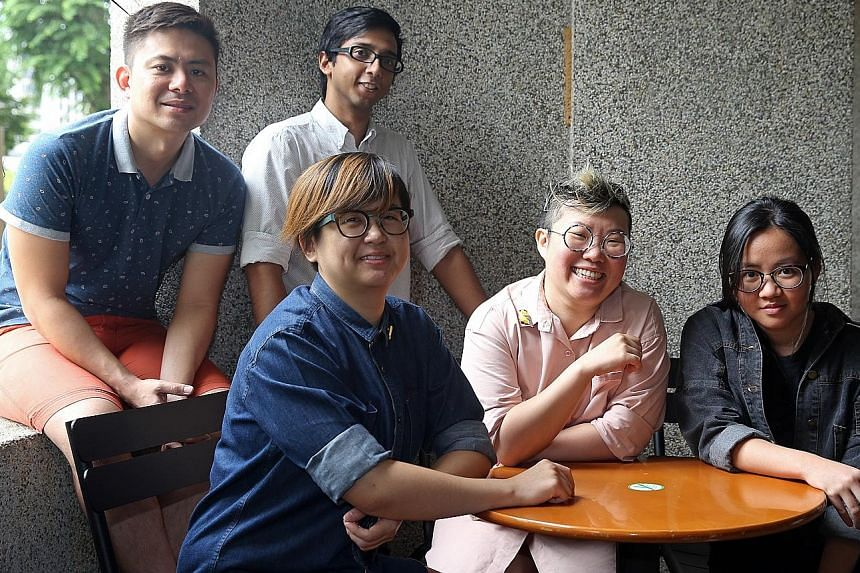 The people behind Betwixt Festival: (seated, from left) organisers Ng Wen Lei and Serena Pang, and artists Samantha Chua, Benjamin Low and Mithru Vigneshwara (back row).