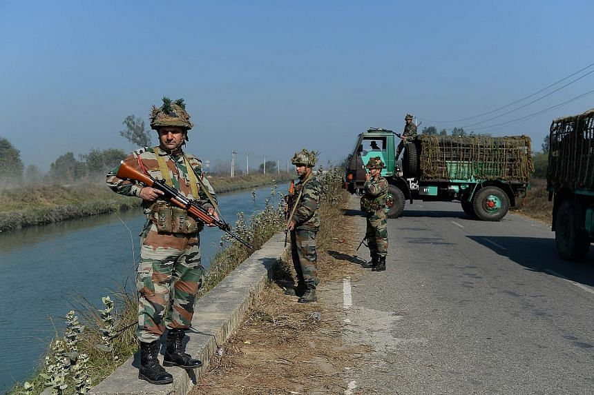 Indian security forces secure the Munak Canal - which supplies three-fifths of New Delhi's water needs for its more than 20 million people - in Haryana's Sonipat district. Delhi's water board said there is extensive damage to the canal and it will ta