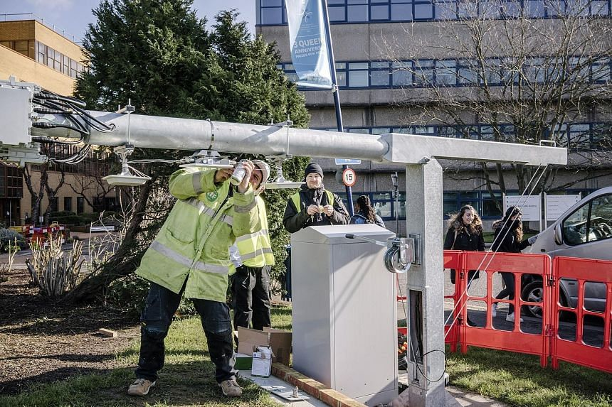 A worker checking an antenna, one of about 70 that are part of the University of Surrey research centre's 5G project.