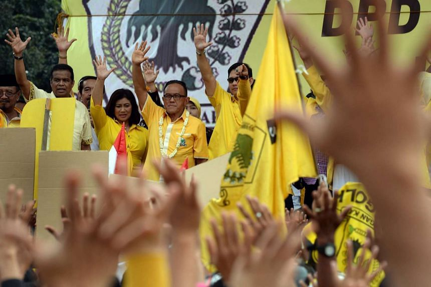 Chairman of the Golkar party Aburizal Bakrie (with garland) with other party members and supporters on Mar 23, 2014.