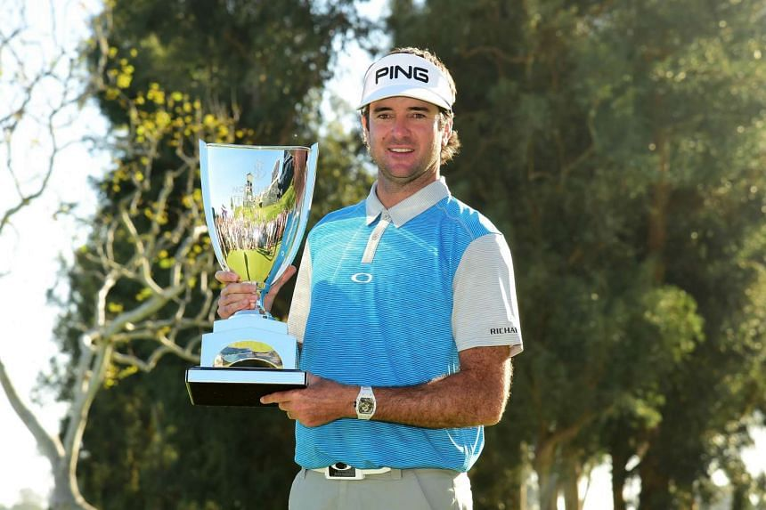 Bubba Watson poses with the trophy after putting in to win on the 18th hole during the final round of the Northern Trust Open.