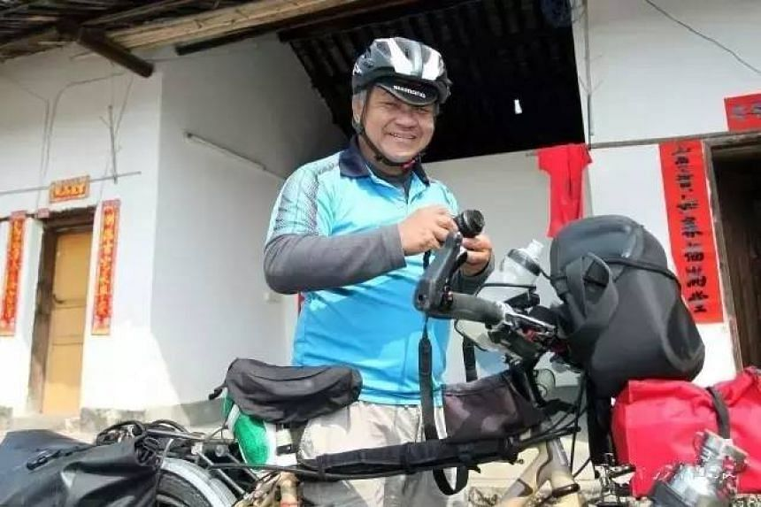 Mr Luo Run Xiang, who is in his 60s, cycled most of the way from Singapore to his ancestral home, Meizhou, in Guangdong.