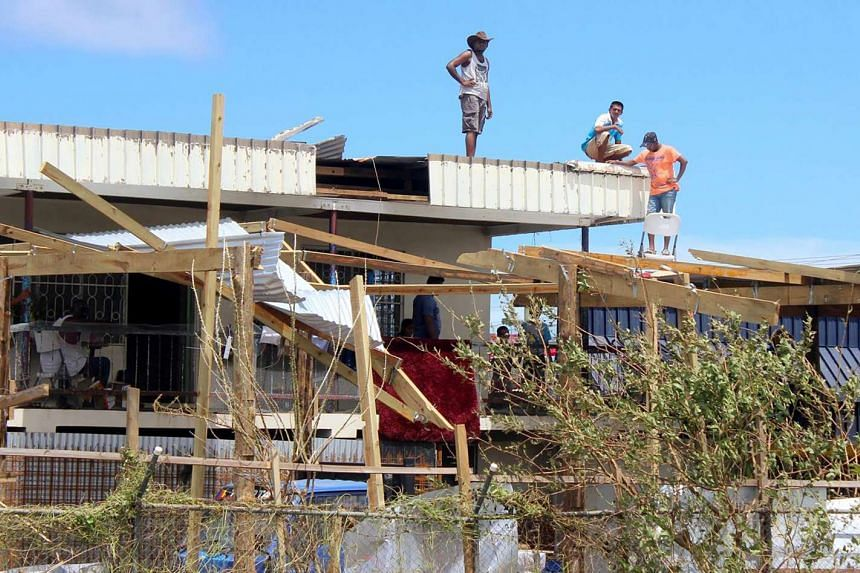 Residents repairing their damaged house following Cyclone Winston in Fiji's Ba district.