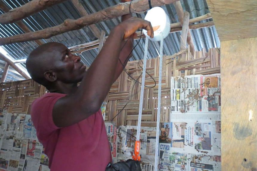 The GravityLight is charged by simply letting a weight fall slowly while attached to a small generator.