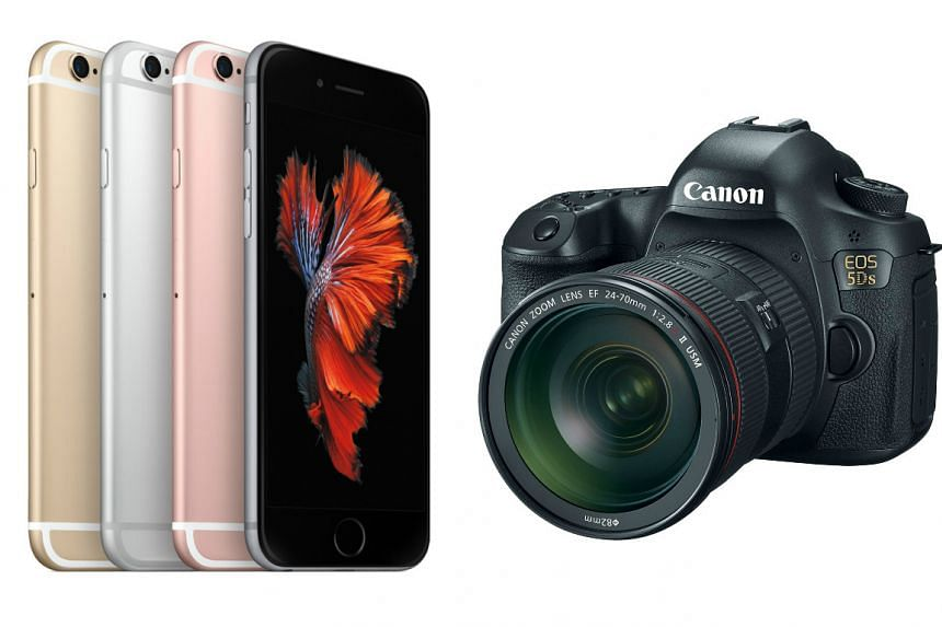 The Apple iPhone 6s (left) and Canon EOS 5DS.