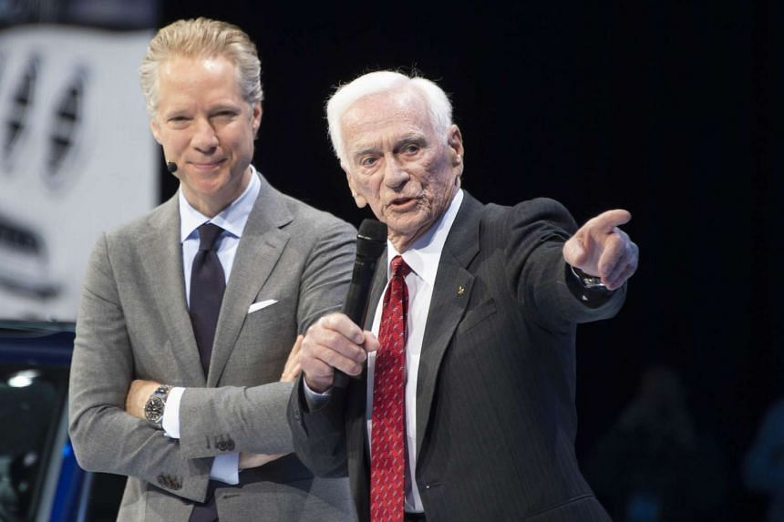 Apollo 10 astronaut Eugene Cernan (right) attends the North American International Auto Show in Detroit, Michigan on Jan 11, 2016.