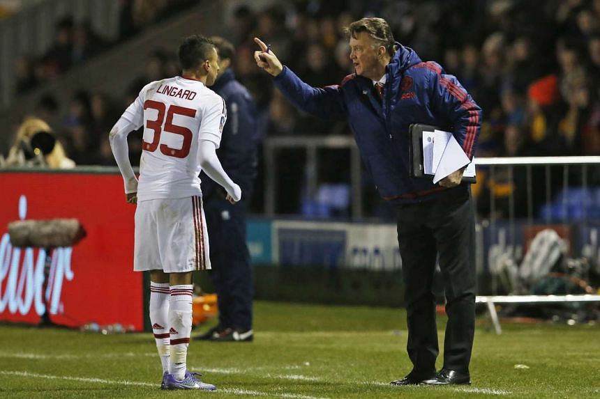Manchester United manager Louis van Gaal with Jesse Lingard at Monday night's match.