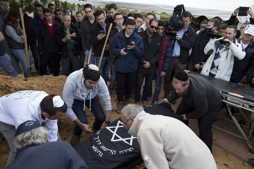 The coffin of Samuel Willenberg is lowered into his grave in Moshav Udim, Israel on Monday (Feb 22).