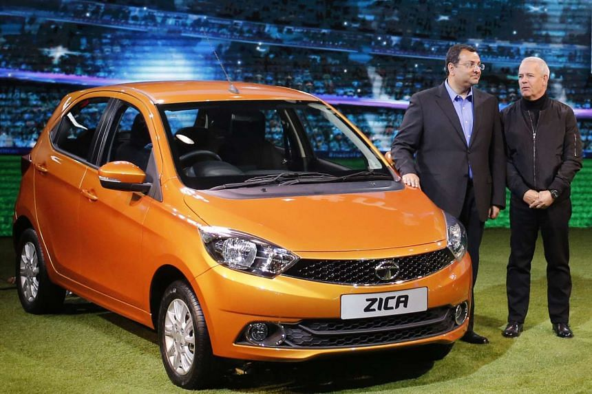 Chairman of Tata Group, Cyrus Mistry (left) and Tata Motors' Head of Advanced and Product Engineering, Tim Leverton, pose with a Zica car during its launch at the Indian Auto Expo on the outskirts of New Delhi, India, on Feb 3.