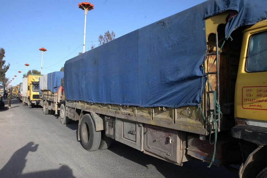 Trucks with relief goods head to al-Moaddamiyeh town in the countryside of Damascus, Syria, on Feb 17, 2016.