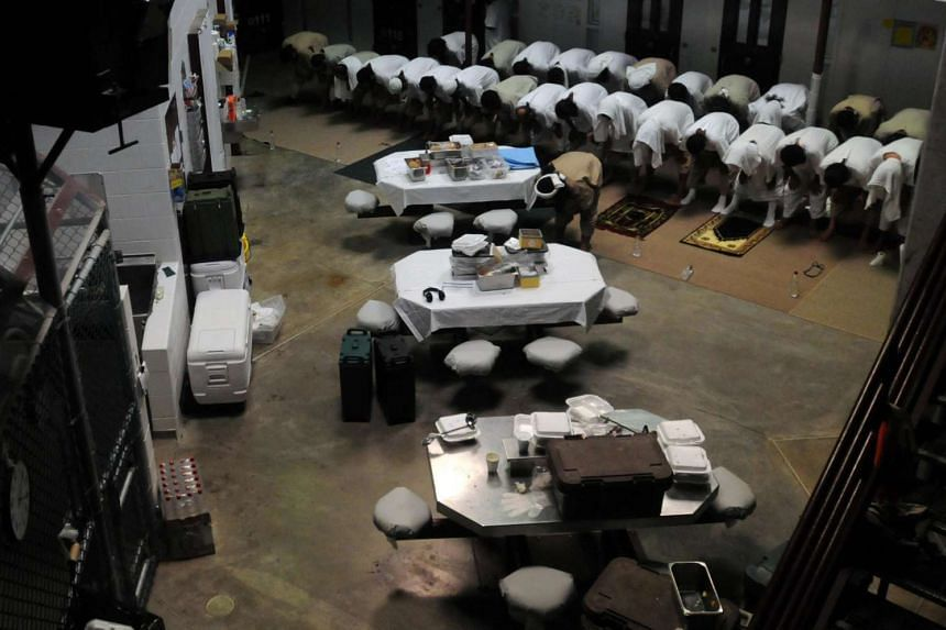 Detainees pray in a communal area of Camp Six at Guantanamo Bay naval base.