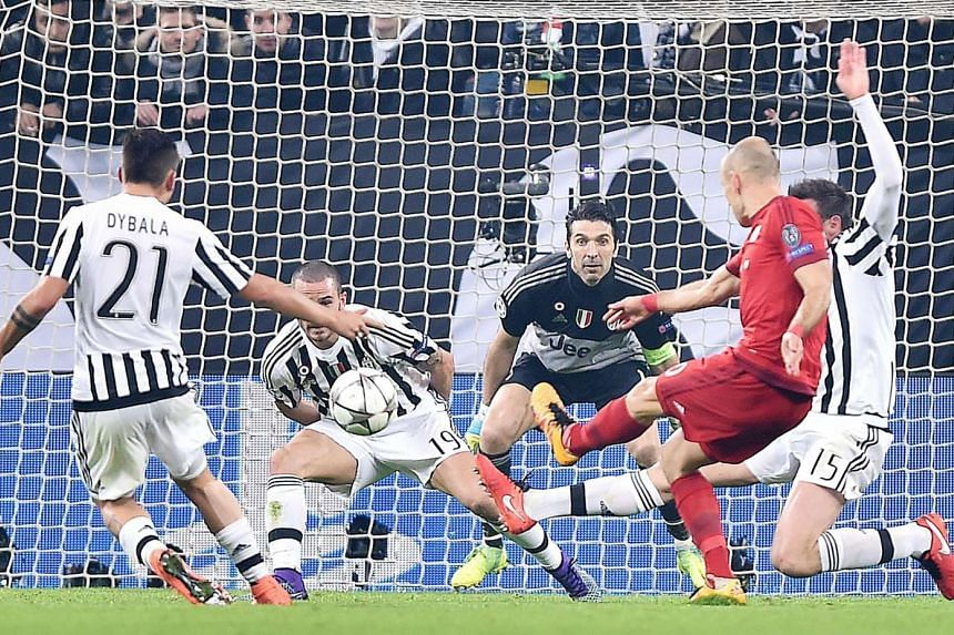 Bayern's Arjen Robben (right) scores a goal during the UEFA Champions League Round of 16 first leg soccer match between Juventus FC and FC Bayern Monaco at Juventus Stadium in Turin, Italy, on Feb 23, 2016.